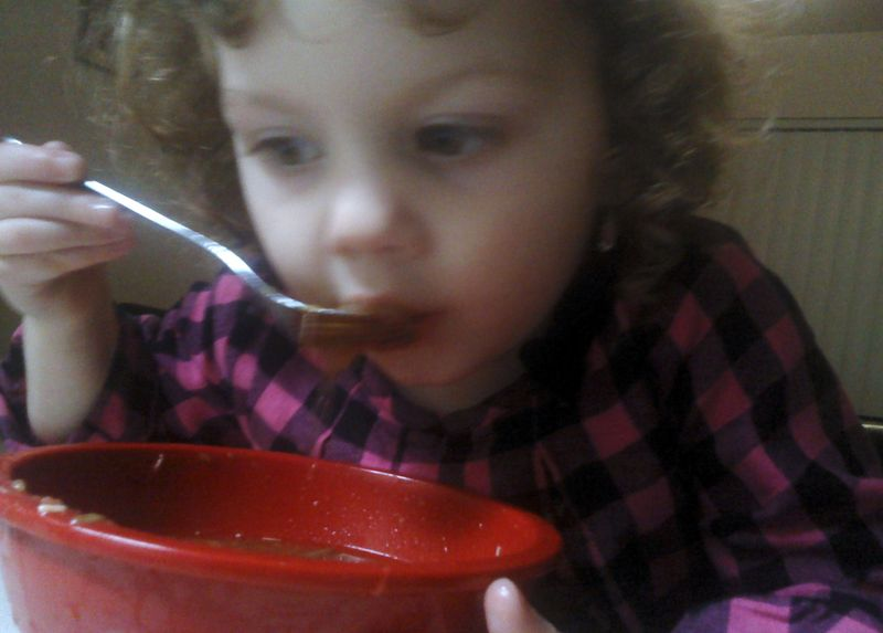 Emma eating the soup